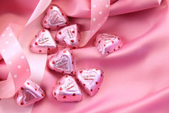 Valentine's chocolate hearts on pink satin Stock Image