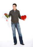 Valentine's: Confident Man with Flowers and Chocolates for Valen Royalty Free Stock Photos