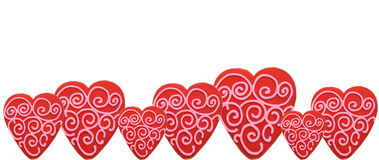 Valentine's cookie border. Red valentine's cookies with pink swirls on white background Stock Image