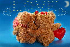 Valentine`s date of teddy bears couple. Embracing couple of teddy bears on valentine`s date sitting with back and looking at stars in the sky forming the word stock images