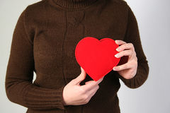 Valentine's day. Women in hand over the heart symbol Royalty Free Stock Images