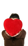 Valentine's day. Women in hand over the heart symbol Stock Photos