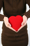Valentine's day. Women in hand over the heart symbol Stock Image