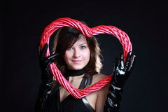 Valentine's Day. Fashion girl with heart-shaped red frame Stock Photos