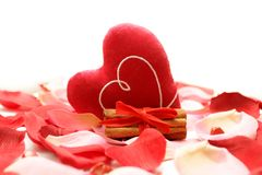 Valentine's day. Rose petals, heart, cinnamon on a white background Royalty Free Stock Photography