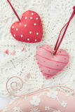 Valentine's Day. Two heart on string, needles with hearts on lace Royalty Free Stock Images