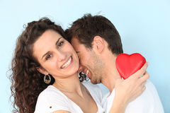Valentine's day. Young couple hugging with red heart Stock Photography