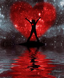 The Valentine's day. Person against the star sky with a heart silhouette, are reflected in water Royalty Free Stock Photography