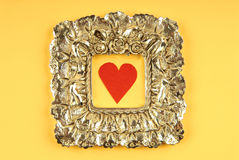 Valentine's Day. Red heart in a frame on a yellow background Royalty Free Stock Images