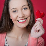Valentine's day. Beautiful young woman holding red heart on Valentine's day Royalty Free Stock Image