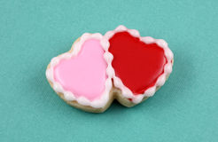 Valentine's Day. Heart cookies on a teal background Royalty Free Stock Photos
