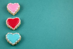 Valentine's Day. Heart cookies on a teal background stock photography