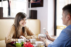 Valentine's Day. Young couple at cafe Royalty Free Stock Images