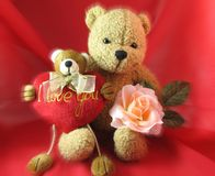 Valentine's Day. Two teddy bears with red heart and pink rose Royalty Free Stock Photos