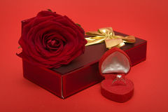 Valentine's Day. Symbols, rose, ring and gift Royalty Free Stock Images