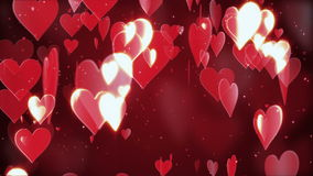 Valentine's day abstract background. Flying hearts and particles on red stock footage