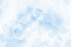 Valentine`s day abstract background of soft blue, white bokeh blur hearts. Stock Images
