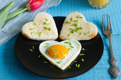 Valentine's Day abstract breakfast with egg heart and tulip Stock Photos