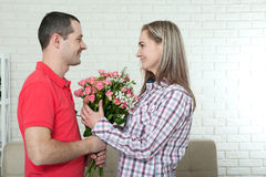Valentine`s day, anniversary, event concept - young woman receiv Royalty Free Stock Photo