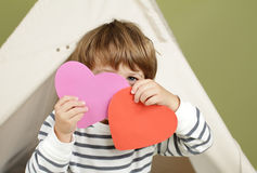 Valentine's Day Arts and Crafts Activity, Heart. Child, kid, engaged in a Valentine's Day arts and crafts activity royalty free stock images