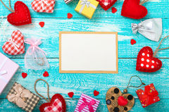 Valentine's day background with blank card and heart shapes on wooden table. Wedding invitation, greeting card for Stock Photo