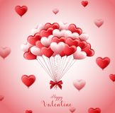 Valentine`s day background with bunch of pink and red heart balloons Stock Images