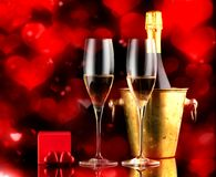 Valentine`s Day Background with champagne, a gift in a box and chocolate sweets Stock Photos