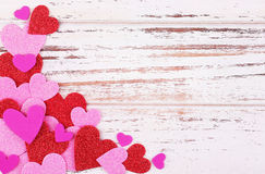 Valentine's Day background. Colorful paper hearts on wooden back Royalty Free Stock Photos