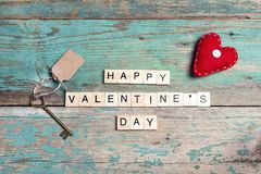 Valentine`s Day background with congratulation, heart and vintage. Key on old boards. Top view Royalty Free Stock Photography