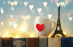 Valentine& x27;s day background. Cup of coffee or tea next to eiffel tower over old books. Valentine& x27;s day background. Cup of coffee or tea next to eiffel Royalty Free Stock Photography