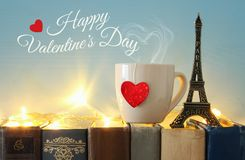 Valentine& x27;s day background. Cup of coffee or tea next to eiffel tower over old books. Valentine& x27;s day background. Cup of coffee or tea next to Royalty Free Stock Image