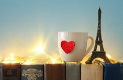 Valentine& x27;s day background. Cup of coffee or tea next to eiffel tower over old books. Valentine& x27;s day background. Cup of coffee or tea next to eiffel Stock Photography