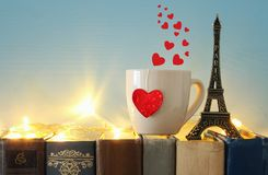 Valentine& x27;s day background. Cup of coffee or tea next to eiffel tower over old books. Valentine& x27;s day background. Cup of coffee or tea next to Stock Images