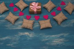 Valentine`s day background with Decorative composition garland on painted wood background. Top view Flat lay stock photos