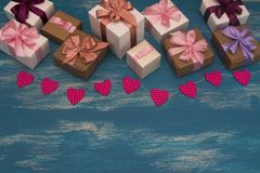 Valentine`s day background with Decorative composition garland on painted wood background. Top view Flat lay stock photo