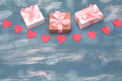 Valentine`s day background with Decorative composition garland on painted wood background. Top view Flat lay stock image