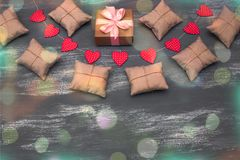 Valentine`s day background with Decorative composition garland on painted wood background. Valentine`s day background with Decorative composition garland on royalty free stock photo