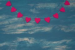 Valentine`s day background with Decorative composition garland on painted wood background. Top view Flat lay royalty free stock image