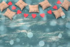 Valentine`s day background with Decorative composition garland on painted wood background. Top view Flat lay royalty free stock images