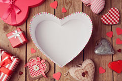 Valentine's day background with empty heart shape box on wooden table. View from above Royalty Free Stock Images
