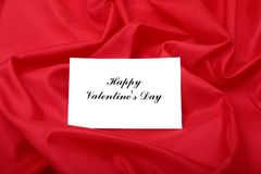 Valentine`s day background with gift box and greeting card. Royalty Free Stock Images