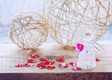 Valentine's day background with glass angel. Wicker balls, confetti heart stock photos