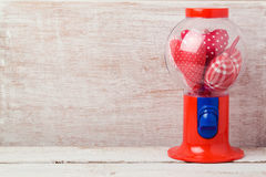 Valentine`s day background with gumball machine and heart shape Stock Images