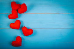 Valentine`s day background with handmade toy red heart made from velvet fabric on vintage blue table. royalty free stock photo