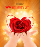 Valentine`s day background. Hands holding heart shaped rose. Stock Photos