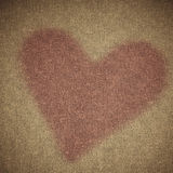Valentine's day background. Heart shape design on brown canvas Royalty Free Stock Photo