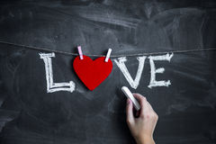 Valentine's day background with hearts in chalkboard Stock Images