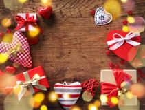Valentine`s day background with hearts and gifts on wooden table. View from above Royalty Free Stock Photo