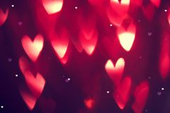 Valentine`s Day background. Holiday background with red glowing hearts royalty free stock photography