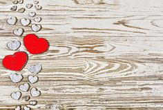 Valentine`s day background. Homemade hearts made of wood on a wooden background. Heart is a symbol of love Royalty Free Stock Images